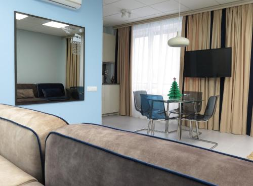 A television and/or entertainment centre at Family Apartments