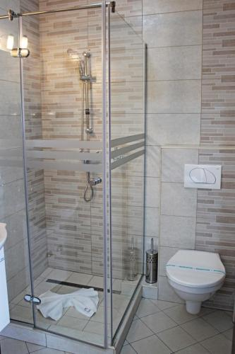 Ванная комната в Pensiunea Casa Iorgovanul Urseni