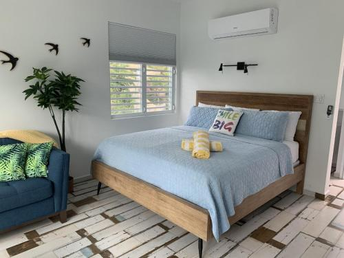 A bed or beds in a room at The Beach Pad