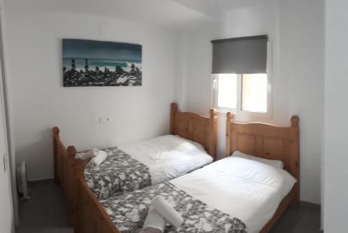 Cama o camas de una habitación en Duquesa Seafront Marina