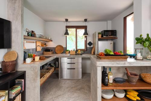 A kitchen or kitchenette at Cape Shark Villas