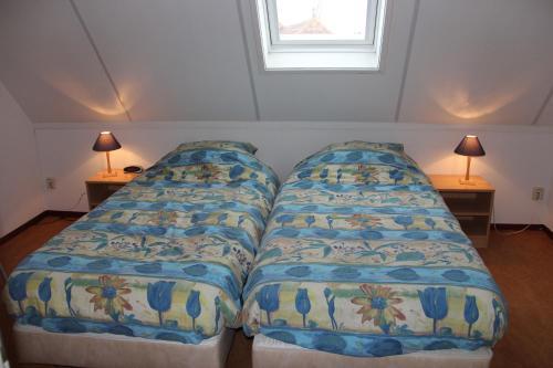 Een bed of bedden in een kamer bij Finistère