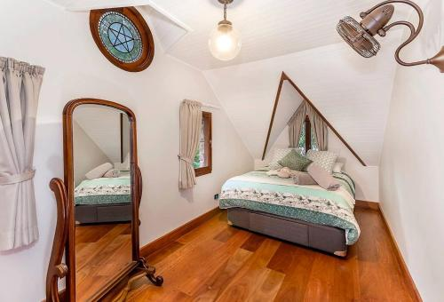A bed or beds in a room at Enchanted Cottage