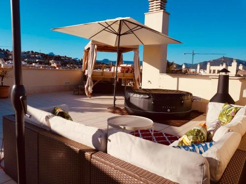 A balcony or terrace at 3 Bedroom with Rooftop Terrace & Jacuzzi