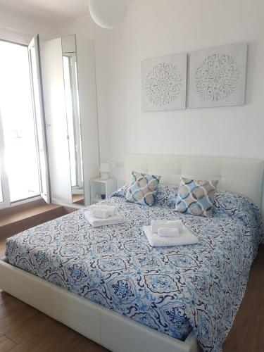 A bed or beds in a room at San Giovanni Sweet Home & Terrace