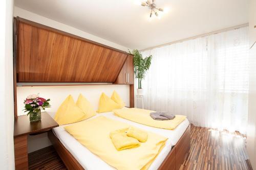 Ein Bett oder Betten in einem Zimmer der Unterkunft Easyapartments Central