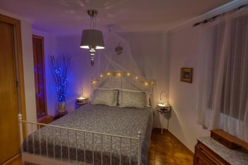 A bed or beds in a room at Sitges Villa Apartment