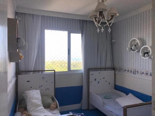 Una cama o camas en una habitación de Frente mar