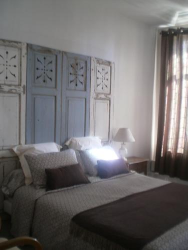 A bed or beds in a room at Chambres d'Hôtes La Belle Haute