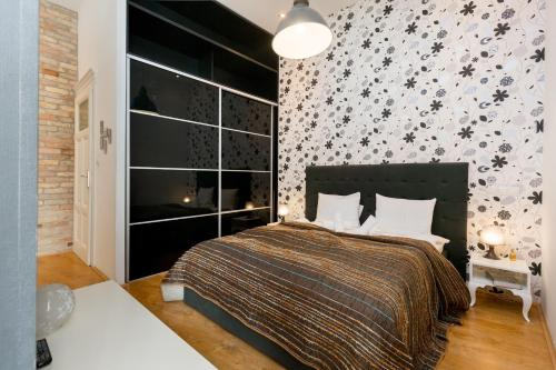Letto o letti in una camera di The Fashion Street Apartment
