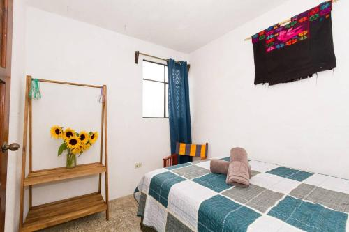 A bed or beds in a room at Colorful flat in the heart of Antigua