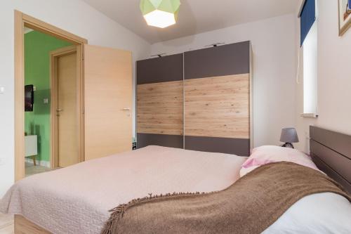 Katil atau katil-katil dalam bilik di Villa May