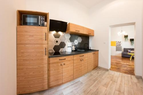 A kitchen or kitchenette at Fresh Apartments