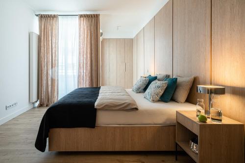Łóżko lub łóżka w pokoju w obiekcie Apartament 24 - OVO