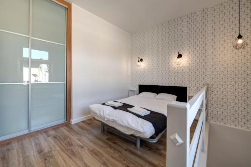 Letto o letti in una camera di Lipowa Apartments