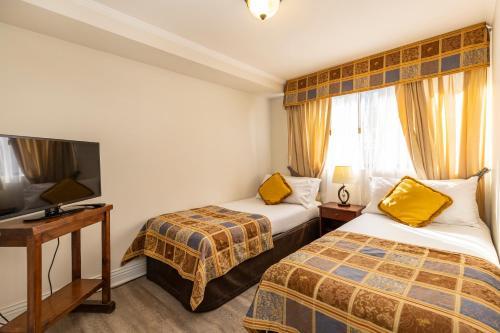 Cama o camas de una habitación en Park Plaza Apartments