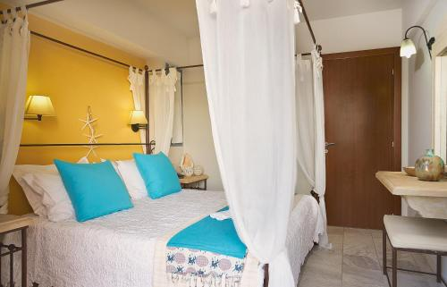 A bed or beds in a room at Golden Bay Hotel Apartments
