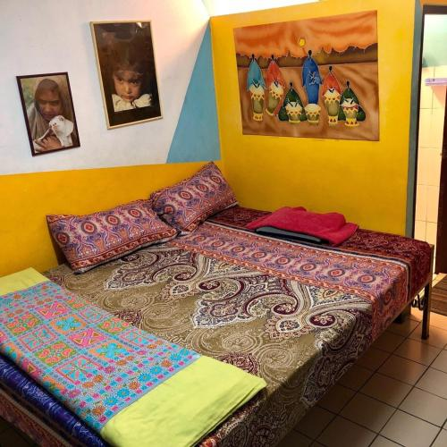 A bed or beds in a room at Vida Guesthouse Chiang Mai