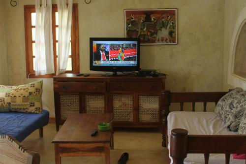 A television and/or entertainment center at Cest La Vie & Spa