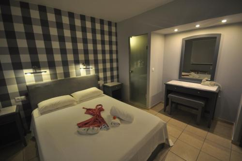 A bed or beds in a room at Ariadnes Holiday Accommodation I