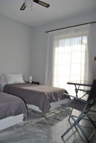Łóżko lub łóżka w pokoju w obiekcie Avli Cosy Rooms