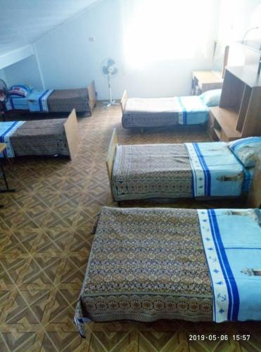 A bed or beds in a room at Guest House Aura