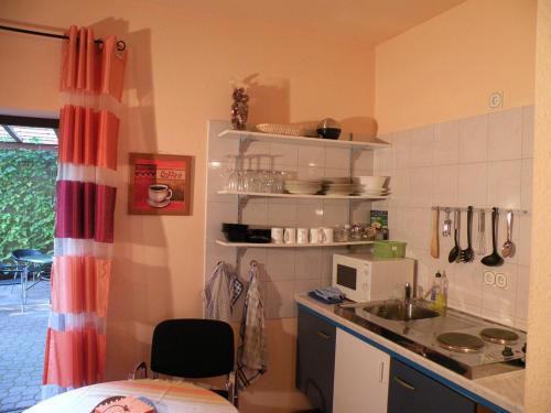 A kitchen or kitchenette at Apartments Schramm