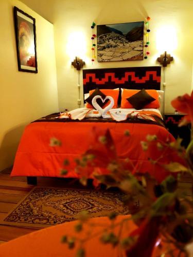 Cama o camas de una habitación en Golden House Inn - Cusco