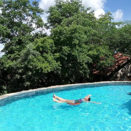 The swimming pool at or near Chalé do Bosque