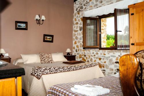Cama o camas de una habitación en Apartamentos Rurales Larrago