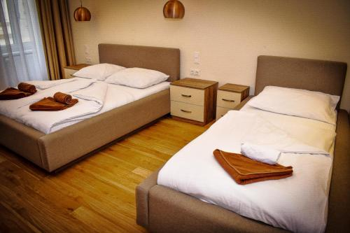 A bed or beds in a room at Aurellia Apartments