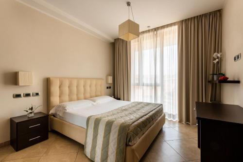 Un ou plusieurs lits dans un hébergement de l'établissement ApartHotel Anghel