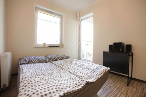 Łóżko lub łóżka w pokoju w obiekcie Apartament w sercu Poznania