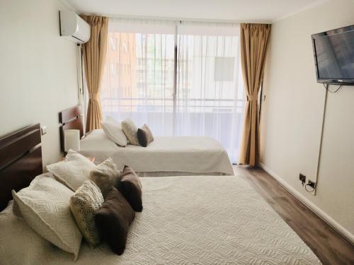 Cama o camas de una habitación en Aconcagua Apartments