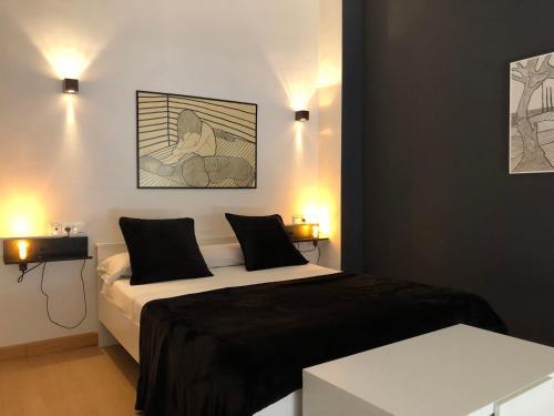 Cama o camas de una habitación en Loft Almagro