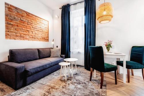 A seating area at Apartamenty Lubartowska Street