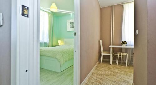 A bed or beds in a room at Pulkovskaya Apartment