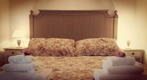 Ein Bett oder Betten in einem Zimmer der Unterkunft Residenza La Pianca