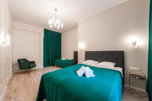 Lova arba lovos apgyvendinimo įstaigoje Delta Apartments Old Town Luxe