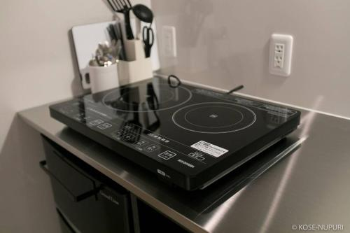 ORIGAMINN 302 & 5 mins PeaceParkにあるキッチンまたは簡易キッチン