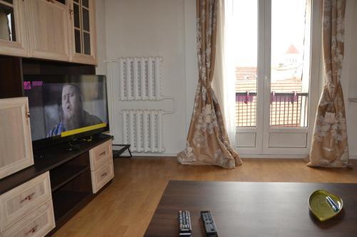 Televizorius ir (arba) pramogų centras apgyvendinimo įstaigoje Beausejour Apartments