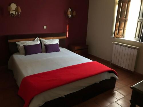 A bed or beds in a room at Casas Do Zagão - Turismo Rural