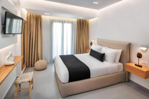 A bed or beds in a room at Harmony Suites