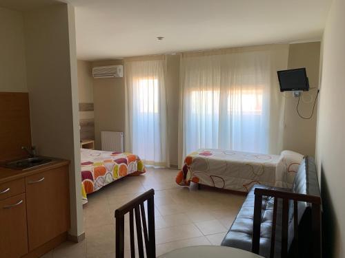 A bed or beds in a room at Aparthotel /Apartamentos Turísticos Raquel's