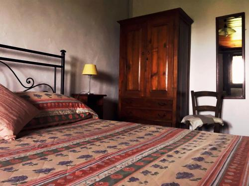 A bed or beds in a room at Le Case Del Vivaio