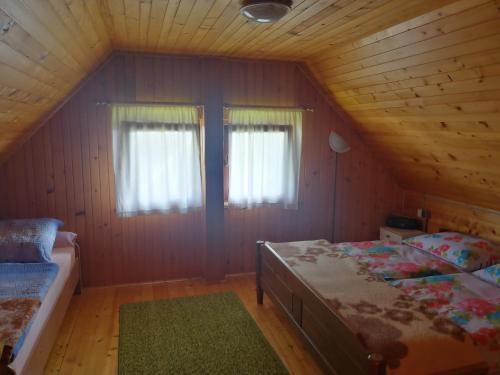 Postelja oz. postelje v sobi nastanitve počitniška hiša Malči