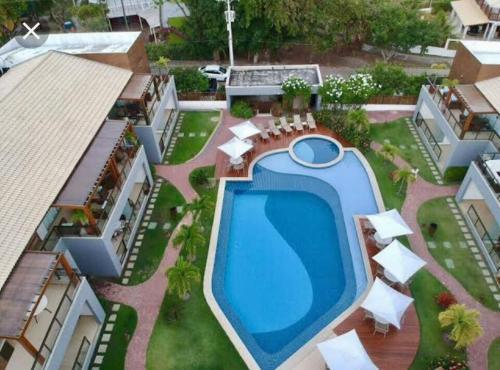 Uma vista da piscina em Condomínio Solaris Imbassai ou nos arredores
