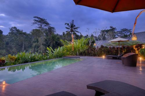 The swimming pool at or near Villa Tegal Tis Ubud