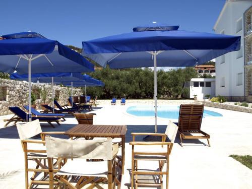 The swimming pool at or near Apartments Villa Olga