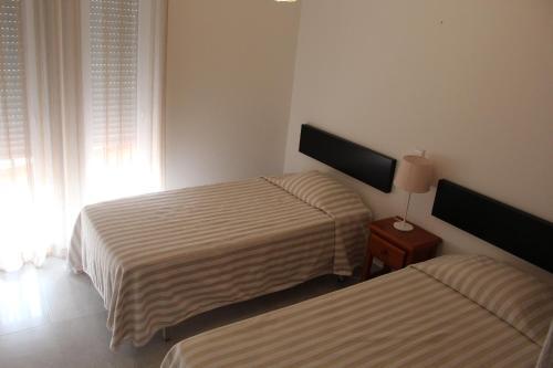Uma cama ou camas num quarto em Clube Alvorférias